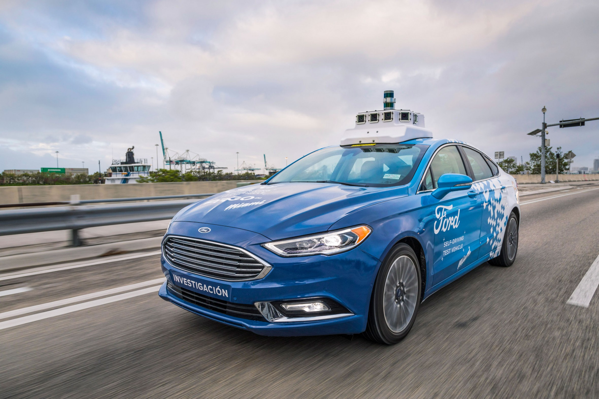 Ford's self-driving taxi passengers may share rides with packages and ads