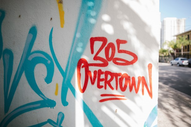 "Photo of spray-painted ""305 Overtown"" on outside wall"