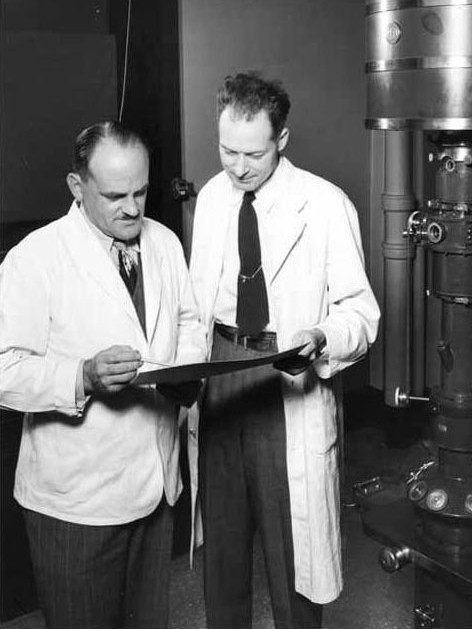 Schmitt consults with Dr. Cecil E. Hall '48