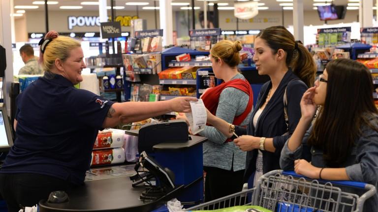 Cashier handing customer reciept