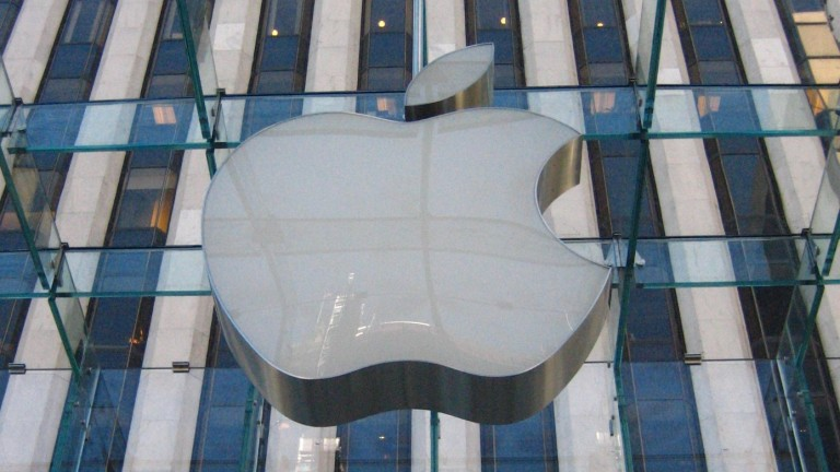 Image of Apple logo on building.