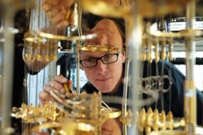 IBM scientist Stefan Filipp looking at the cryogenic refrigerator