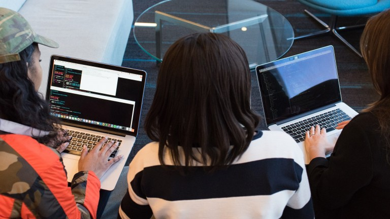 Image of three women working at computers.