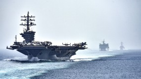 The American's Eisenhower Carrier Strike Group transits the Strait of Hormuz in 2016.