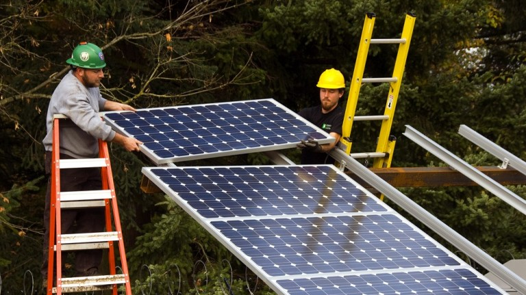Solar workers installing solar panels