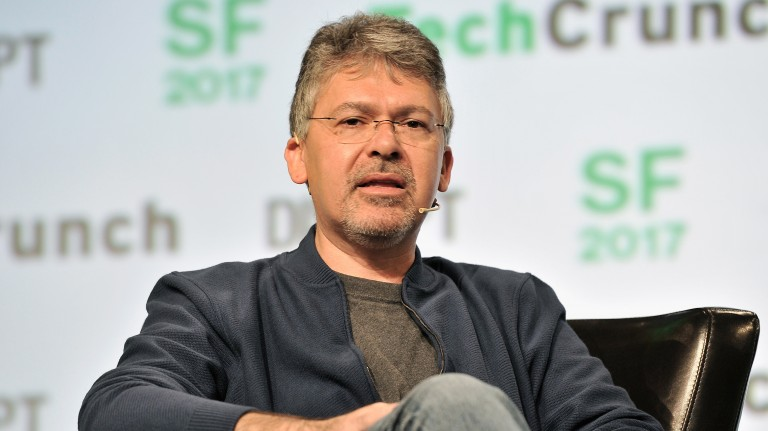 Photo of John Giannandrea speaking on stage at a TechCrunch conference