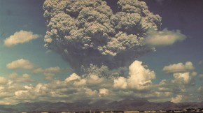Giant ash cloud from the eruption of Mount Pinatubo, 1991 towering above farms and agricultural lands in the Philippines.