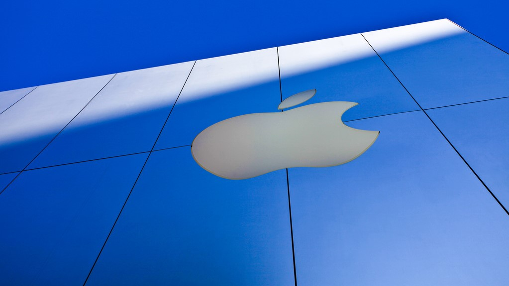 Image of Apple logo on an Apple store outside.