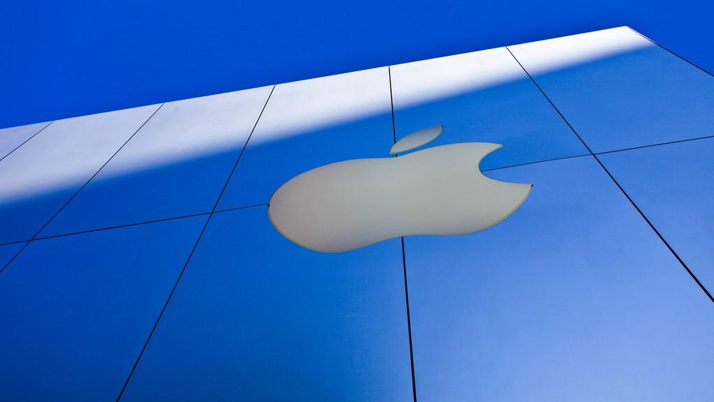 Image of Apple logo on an Apple store outside.