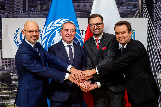 Officials shake hands at the press conference on December 16, 2018 at the UN's COP24 meeting in Poland.