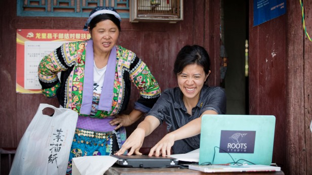 Photo of Hui and woman using laptop