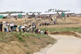 An image showing a group of Rohingya refugees relocating to safer areas from areas in the Kutupalong settlement at risk of landslides and floods