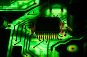 Computer chip with green circuit board