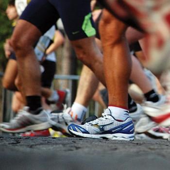feet in sneakers walking
