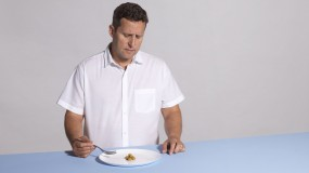 An image of Adam Piore in front of a plate of olives