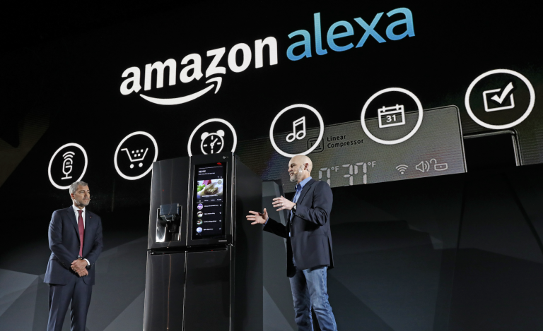 The Amazon Alexa logo looms large over a demo for a smart fridge.