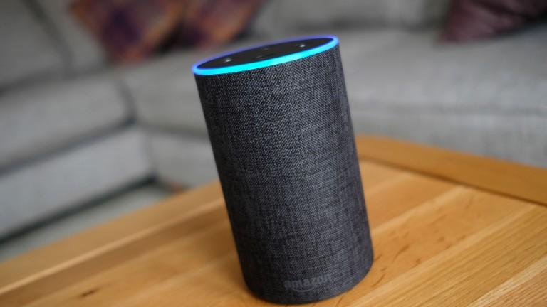 An Amazon Echo smart speaker on a table