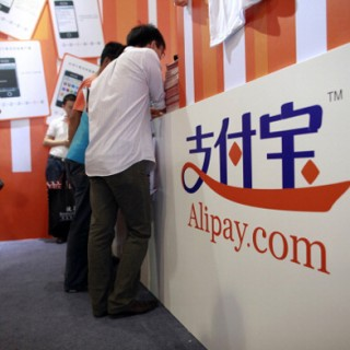 People at an Alipay counter