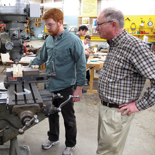 Hobby Shop director Ken Stone with student