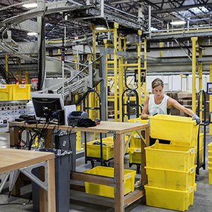 Inside Amazon's Warehouse, Human-Robot Symbiosis - MIT