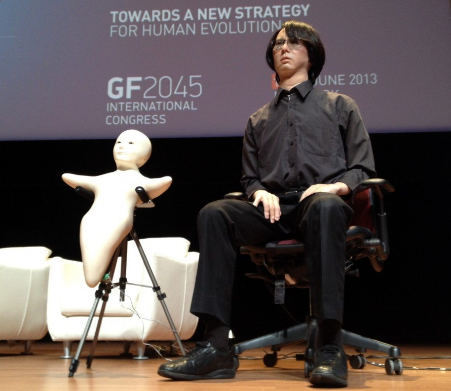 man and baby androids on stage