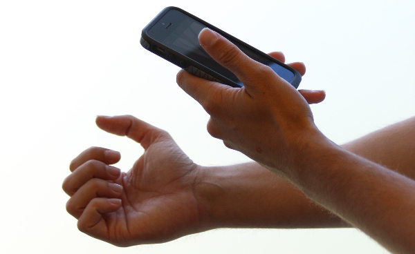 A person photographing their fingernails for diagnostic purposes
