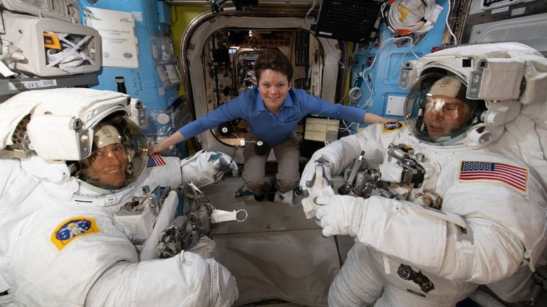 NASA astronaut Anne McClain assists fellow NASA astronauts Christina Koch (left) and Nick Hague as they verify their U.S. spacesuits are sized correctly and fit properly ahead of a set of upcoming spacewalks.