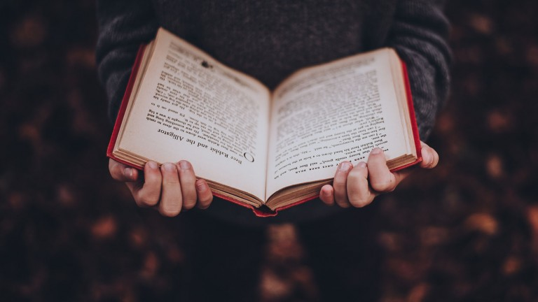 Reading a book.