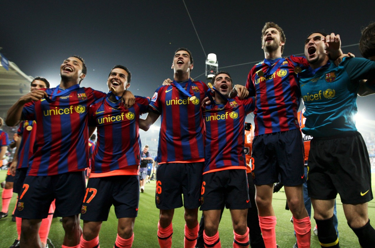 Barcelona soccer team members Jeffren, Pedro, Sergio Busquets, Xavi, Gerard Pique, and Pinto