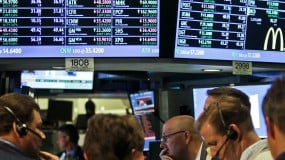 Traders on the stock trading floor
