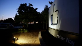 """the Facebook """"like"""" symbol is illuminated on a sign outside the company's headquarters in Menlo Park, Calif."""