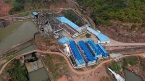 A Sichuan bitcoin mining farm by a hydropower dam