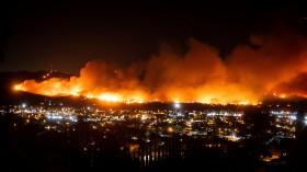 Photograph of smoke from the Maria Fire billows above Santa Paula, Calif., on Thursday, Oct. 31, 2019.