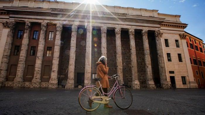 Italian walking with bicycle