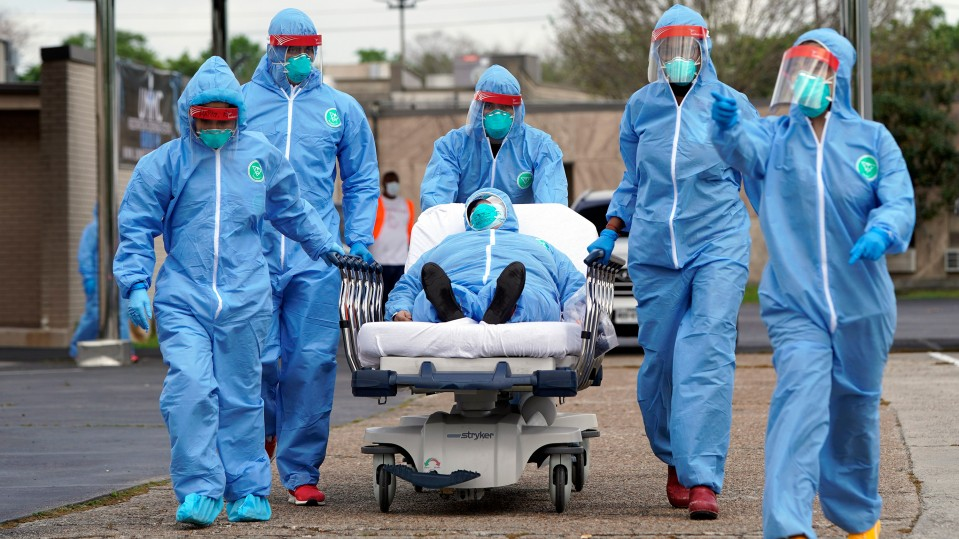 A person is taken into the United Memorial Medical Center in Houston after undergoing COVID-19 testing earlier this month.