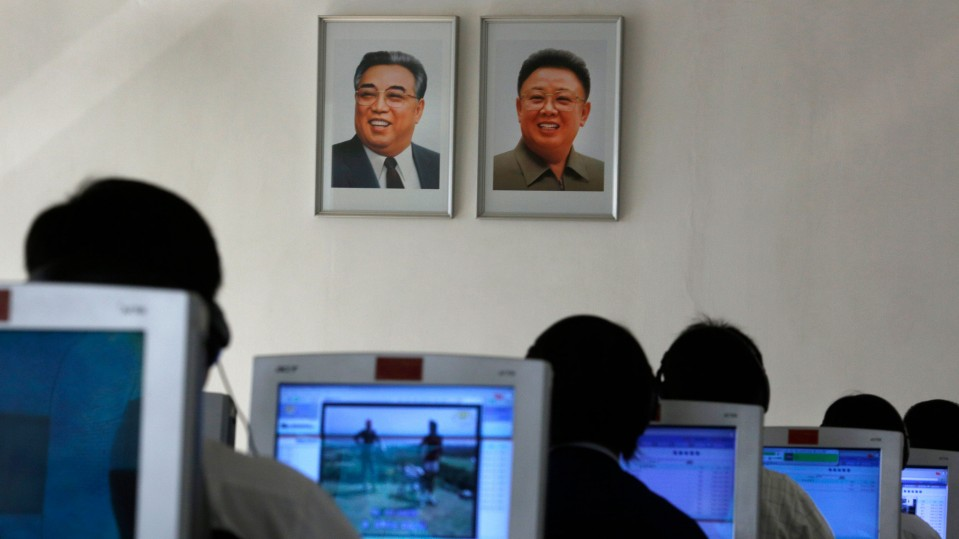 North Korean students use computers near portraits of the country's later leaders Kim Il Sung, left, and his son Kim Jong Il at the Kim Chaek University of Technology in Pyongyang, North Korea.
