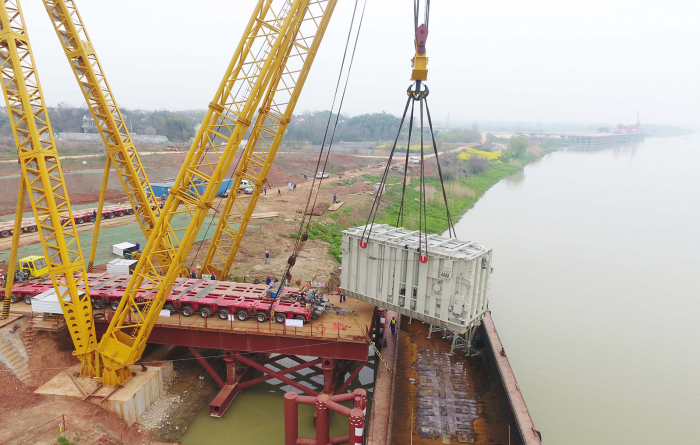 Photograph of a crane lifting the world's most powerful converter transformer, developed for State Grid's 1.1-million-volt transmission line, in China's Anhui province in March 2018.