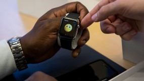 A man checks an Apple Watch