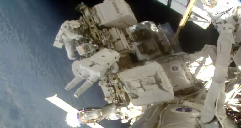 Astronauts walking outside the International Space Station