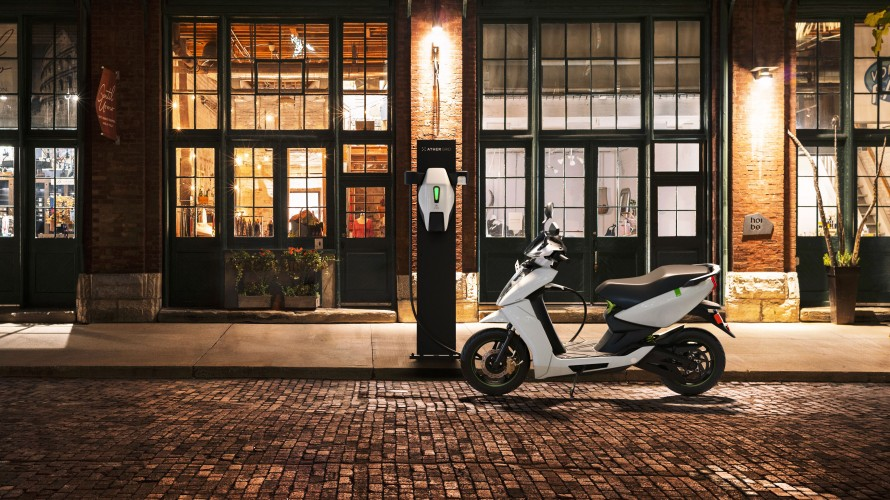 Photo of Ather 4 electric scooter connected to outdoor charging station