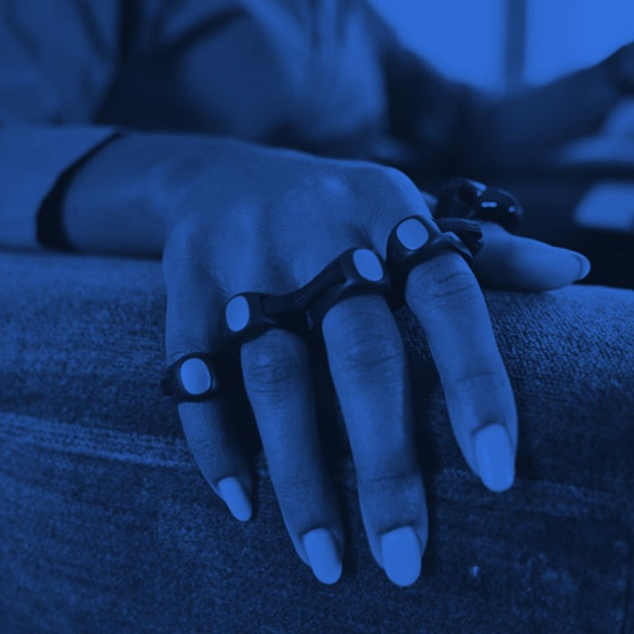 Image of person wearing connected ring typing device that fits over fingers