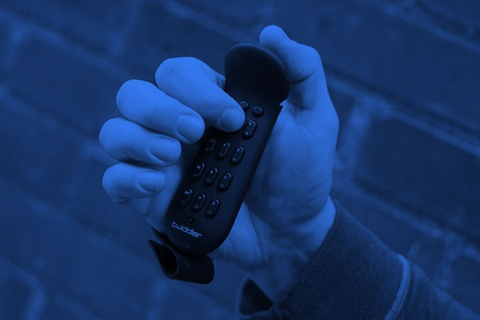 Image of hand holding typing device