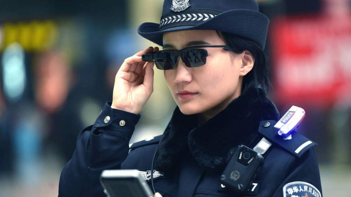 A Chinese police officer wearing facial recognition glasses.
