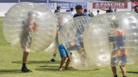 People playing a game where they each are in a bubble.