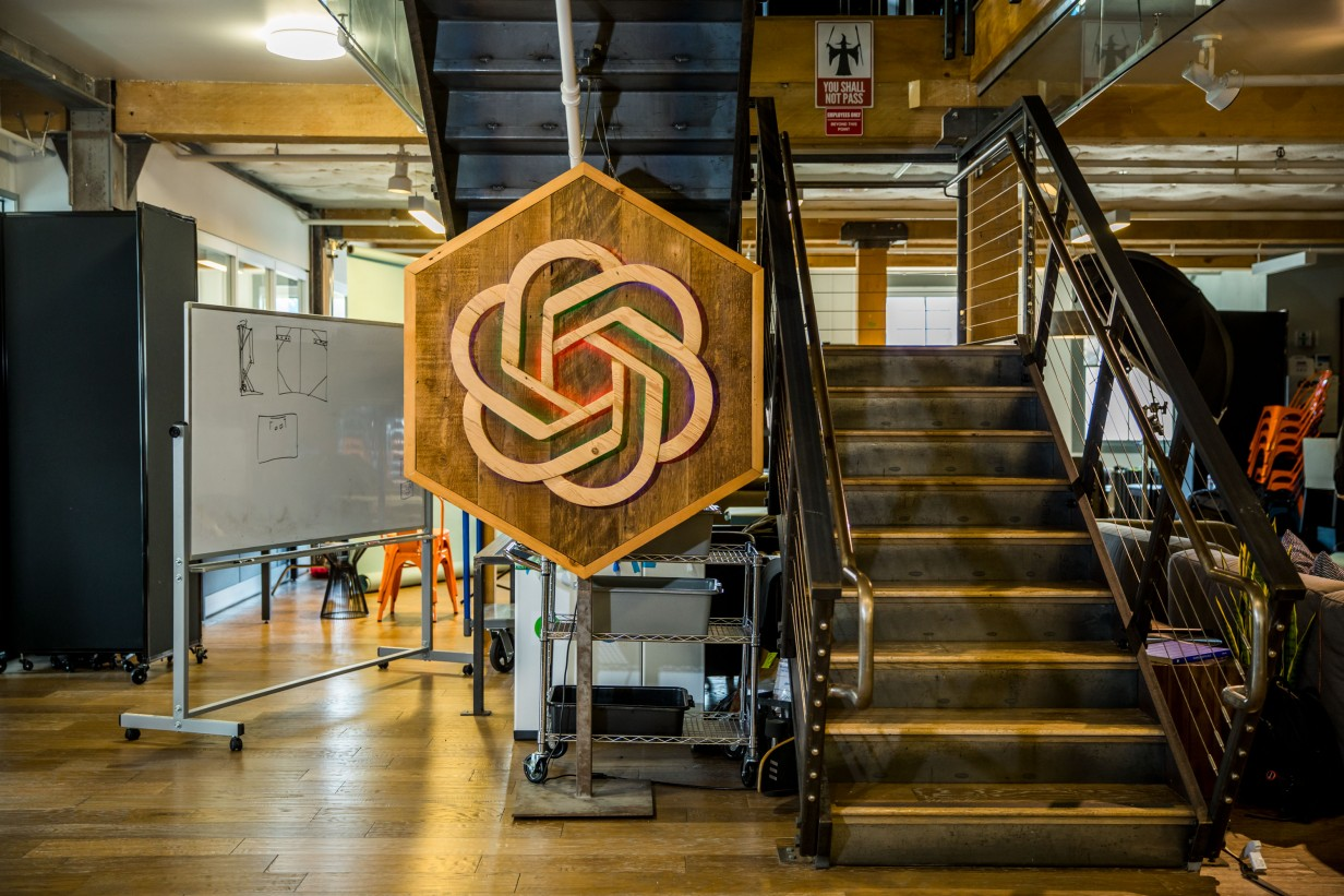 The OpenAI company's logo hanging in its main office.