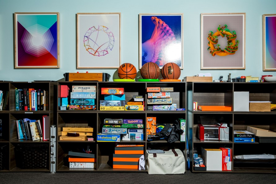 Photograph of books, games, and posters in the office space