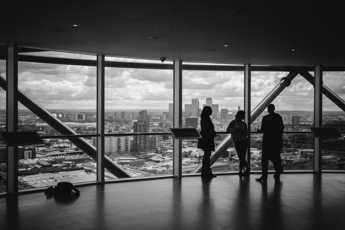 People meeting with a view of a city skyline