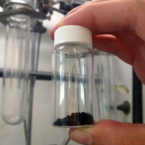 hand holding vial of isomers
