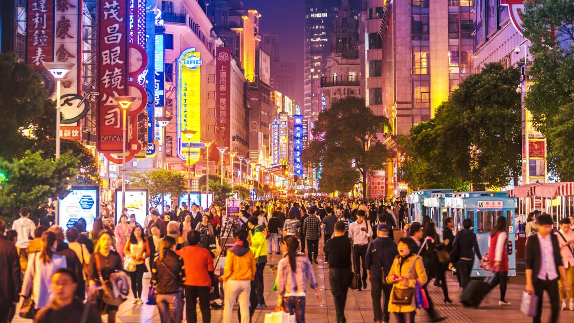 A crowd of people walk in Shanghai.