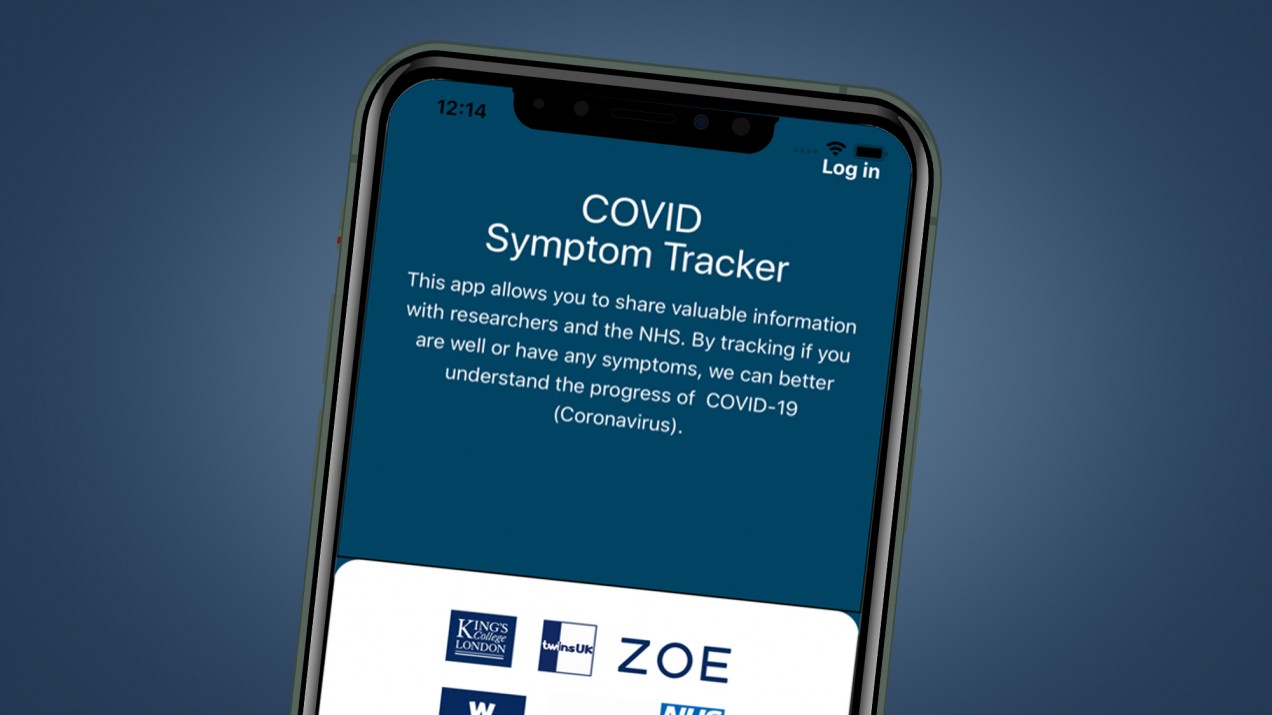 A phone with the Covid Symptom Tracker app open